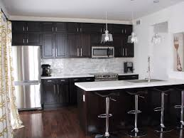 kitchen cabinets and backsplash kitchen with dark cabinets and white quartz counters and marble