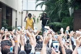 bachchan waves to his fans outside his bungalow jalsa