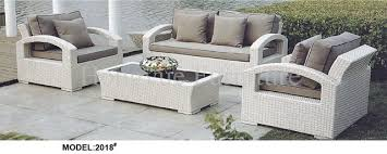 garden white rattan sofa set furniture with cushions in garden
