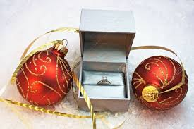 engagement ring in silver box with two and gold