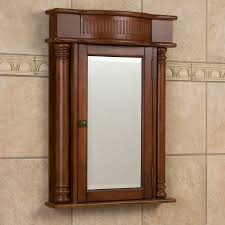 brown varnished wooden medicine cabinets with rectangular mirror