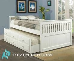 white captains bed with trundle and storage foter