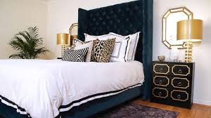 hollywood regency bedroom navy blue and gold bedroom with dorothy draper style nightstands