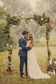 wedding arch leaves picture of branch wedding arch with leaves and bold flowers for a