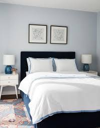 blue boy bedroom with navy blue velvet headboard transitional