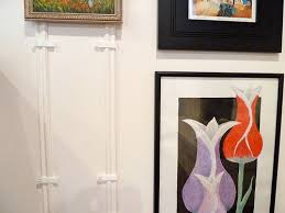 the easy way to hang artwork on paneling without nails it u0027s
