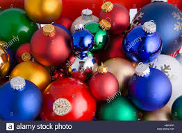 colorful tree bulb ornaments piled on top of