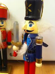decorating large wooden black soldier nutcrackers for