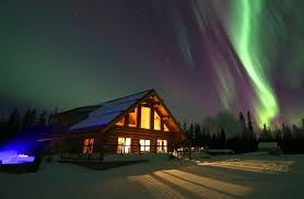 imagine a log cabin christmas under the northern lights country