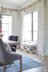 blue curtain white wall paint and big window plus interesting