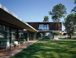 wood deck glass walls cantilevered house in the town of hard