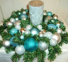 blue and silver ornaments with green garland and