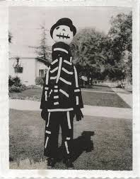 tim burton showing off a halloween costume made by his mother