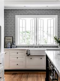subway tile wall white cabinets wood floor kitchen concepts