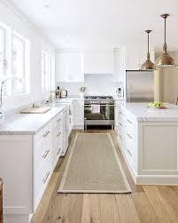white kitchen cabinets with oak flooring instagram photo by nicki dobrzynski jul 16 2016 at 4 47am