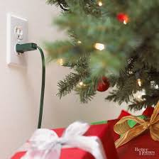 remove lights from pre lit tree how to put lights on a christmas tree better homes gardens