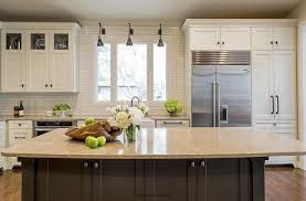 white and gray kitchen with gold countertops transitional kitchen