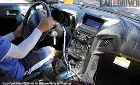 spied 2013 hyundai genesis coupe interior gets its elantra on