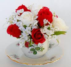 teacup silk flower arrangement creamy white u0026 red rosebuds