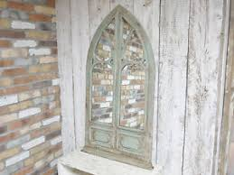 large decorative gothic arched door wooden framed garden wall