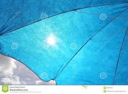 Beach Sun Umbrella Sun Filtering Through Blue Sun Umbrella Stock Photo Image 48606787
