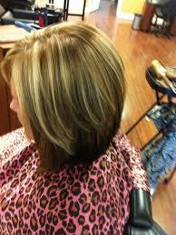 bob hair lowlights dark brown underneath dark blonde lowlights bright blonde