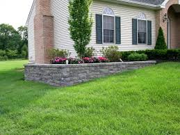 a retaining wall is used on this project to level the planting bed