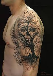 awesome illusion tree skull tattoo on shoulder by milan tattoos