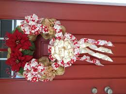 gold and red christmas wreath poinsettias and leaf accents from