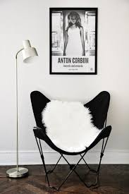black butterfly reading chair with white fur blanket with