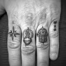 creative mens cross tattoo on finger foot hand and smallish