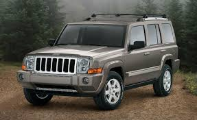red jeep commander jeep commander says yes to mud