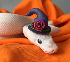 spirit halloween jumping snake gandalf wears hats home facebook