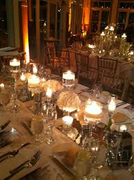 decorating glass hurricane vases with green seeds and candle for