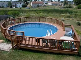 swimming pool wooden pool deck and railing also patio chairs