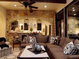 nice brick stone wall fireplace designs with wooden fireplace fascinating custom home concierge interior design with exposed stone wall also hanging ceiling plus brown fabric