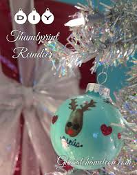 12 days of diy ornaments day 6 thumbprint reindeer ornament