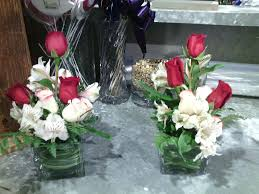 vase full of tulips serve as a dining table centerpiece