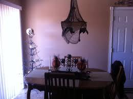my halloween table decor chandelier w black cheese cloth draped