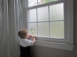 i finally put privacy film on the sidelight windows of our front