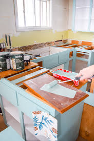 where can i get kitchen cabinet doors painted how to paint your plywood kitchen cabinets pmq for two