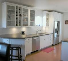 galley kitchen with breakfast bar white cabinets grey counter