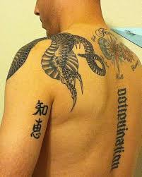 30 magnificent back tattoos slodive