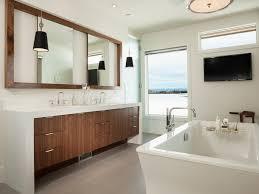 bathroom clerestory window gray floor tile wall mounted tv white