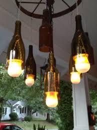 Wine Bottle Light Fixtures Wine Bottle And Wagon Wheel Chandelier Junkmarket Style