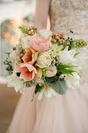 hydrangea wedding bouquet blush amaryllis tulip hydrangea and berry winter wedding