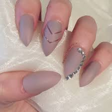 matte stiletto false nails with chevron negative design and