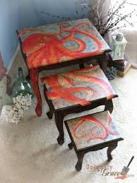 set of three end tables three nesting tables and an octopus