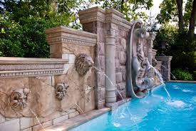 pool fountain heads each faux stone sculpture acts as a fountain