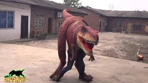 velociraptor costume walking animatronic velociraptor costume attacks car